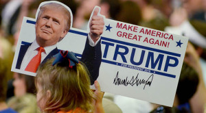 A young supporter holds up a campaign sign for U.S. Republican Presidential candidate Donald Trump at Madison Central High School during at a campaign rally in Madison, Mississippi March 7, 2016. REUTERS/Rick Guy